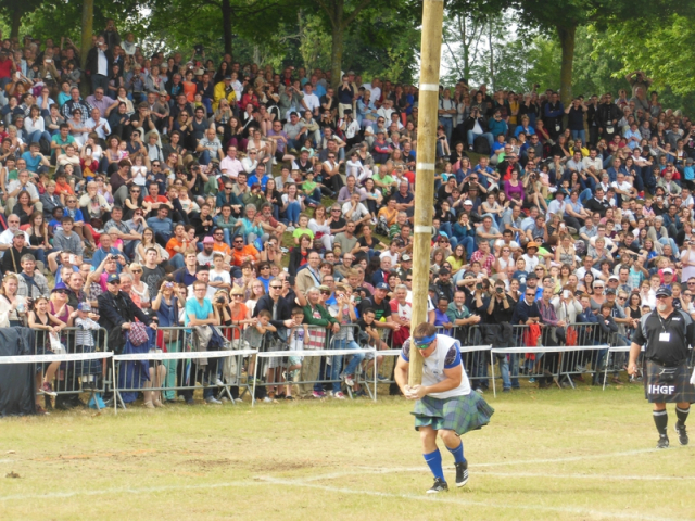 Tossing the caber competition at a Highland Games event in Bressuire in Deux-Sevres