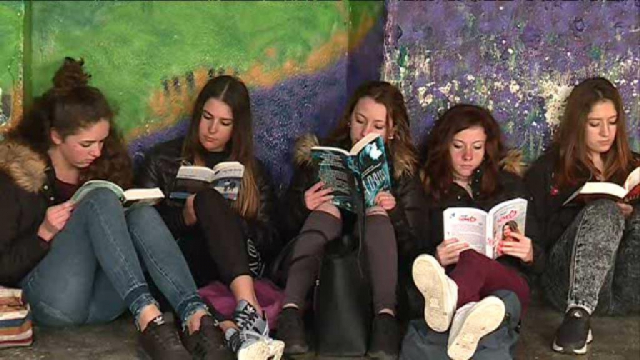 Group of girls sit reading books
