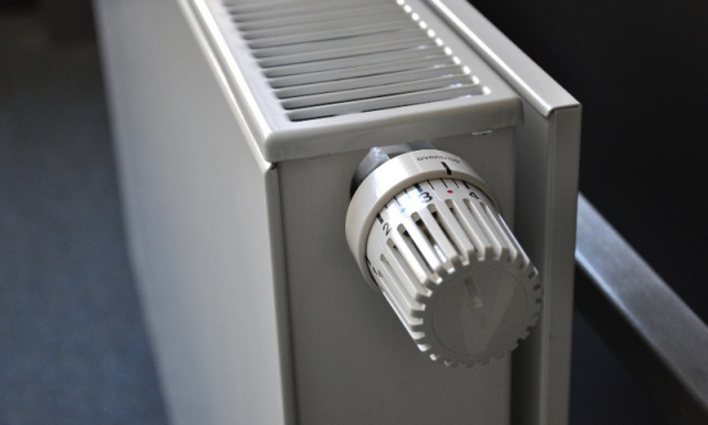 A white electric radiator with individual thermostat