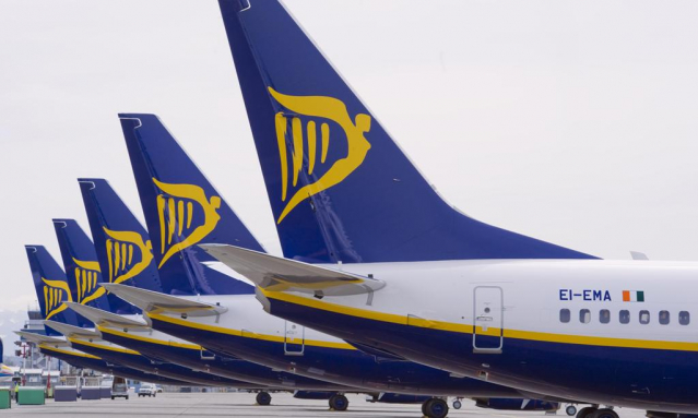 A line-up of aircraft tailfins with Ryanair logos