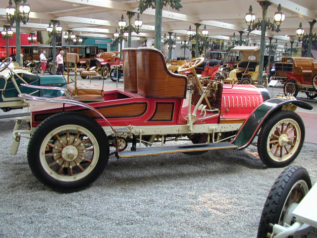 Red vintage car on display at exhibition