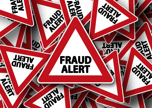 Triangle warning signs saying fraud alert