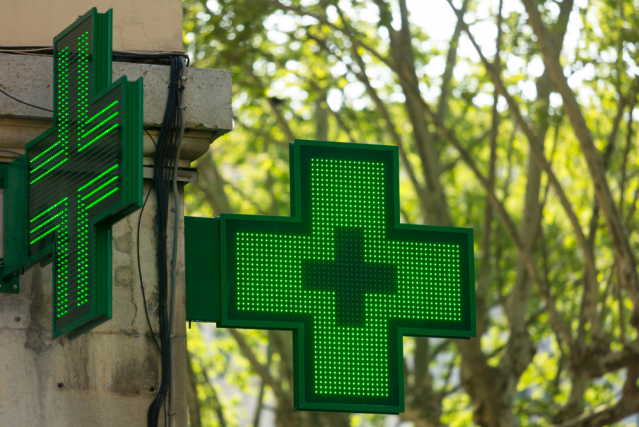 Closeup of a green pharmacy sign in France