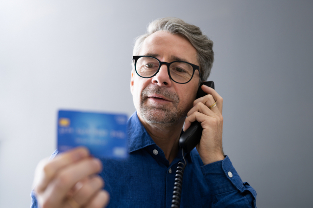 Man taking scam call on phone