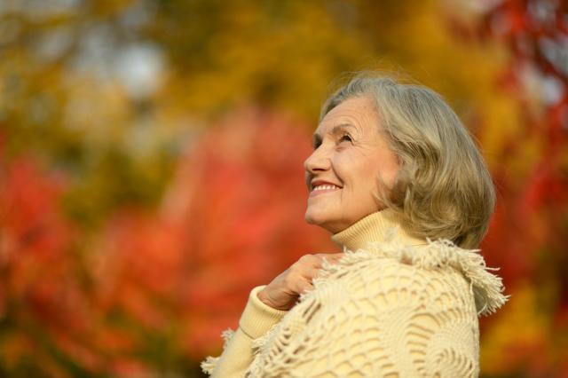 Lady enjoying an autumn walk