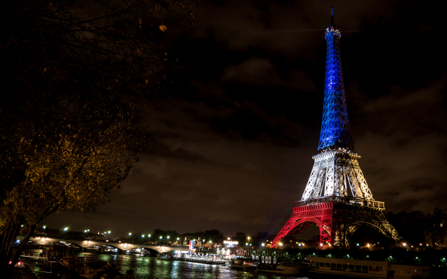 The Eiffel Tower illuminated in the colours of the tricolore