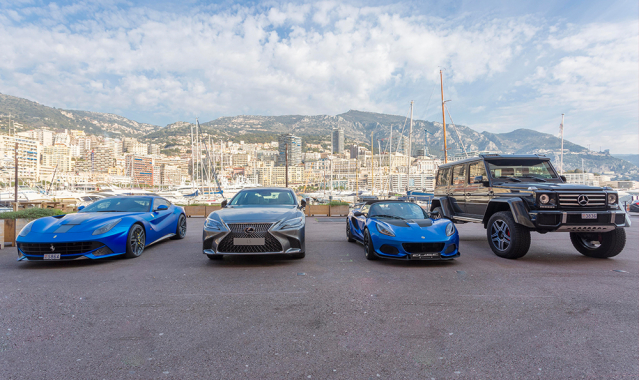 Line up of cars in front of Monaco background