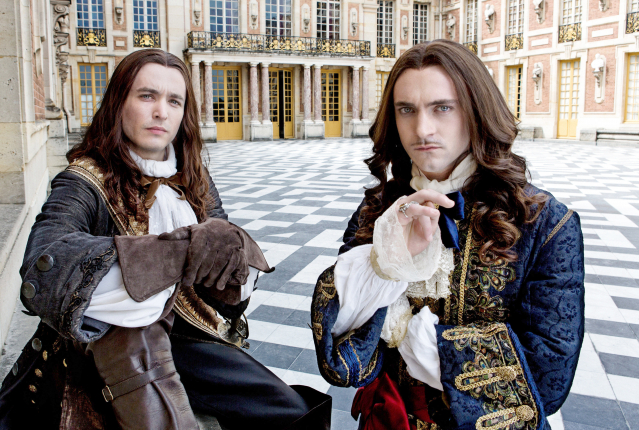 Vlahos, as Philippe, alongside George Blagden, who stars as Louis XIV