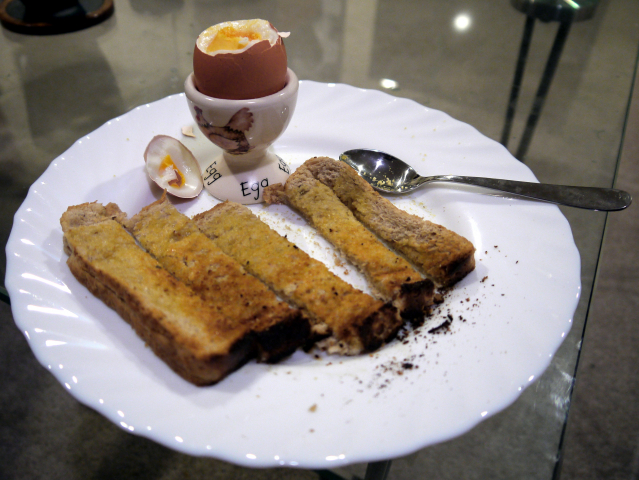 boiled egg and soldiers on a plate
