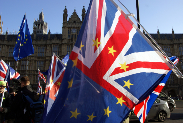 UK and EU flags fly in a demonstration outside Parliament