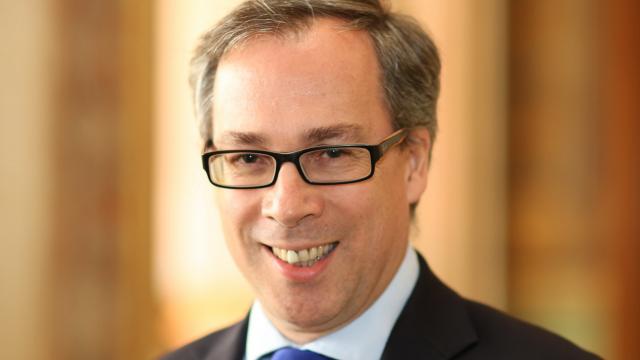 Head shot of British ambassador to France Ed Llewellyn smiling