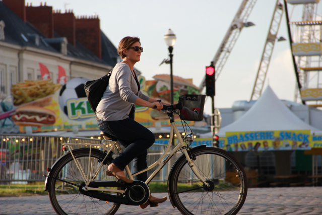 A woman riding a bicycle in Nantes