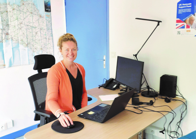 IOM caseworker Elisabeth Kelsey at her desk