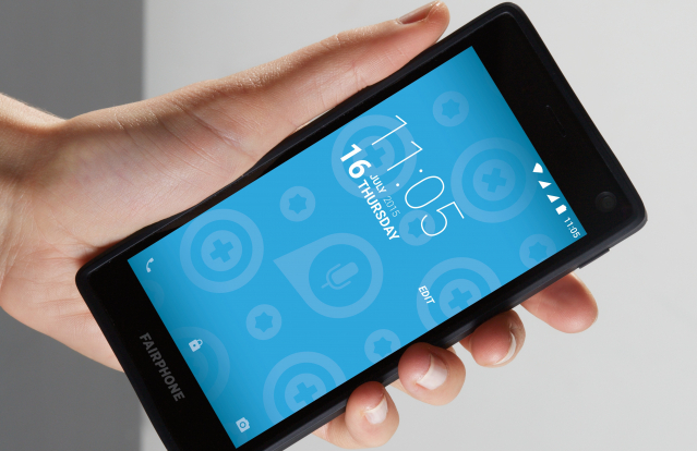 Hand holding a Fairphone 2 mobile phone
