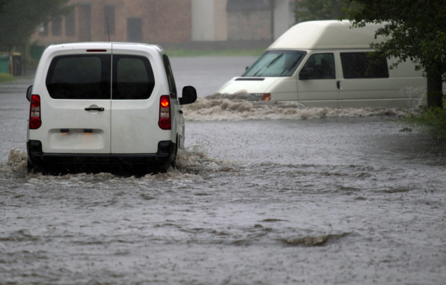 vehicles in flooded street