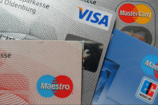 Close-up of a series of bank cards, including Visa, Maestro and MasterCard