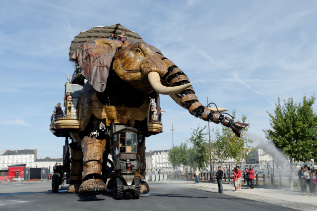 The four-storey high mechanical Grand Elephant parades through the streets of Nantes