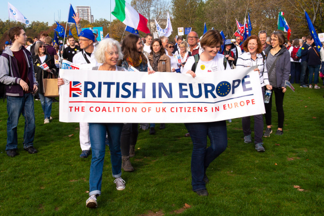 British in Eurrope co-chairs on a march with a banner