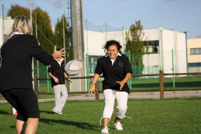 women rugby players passing a ball during a skills training session