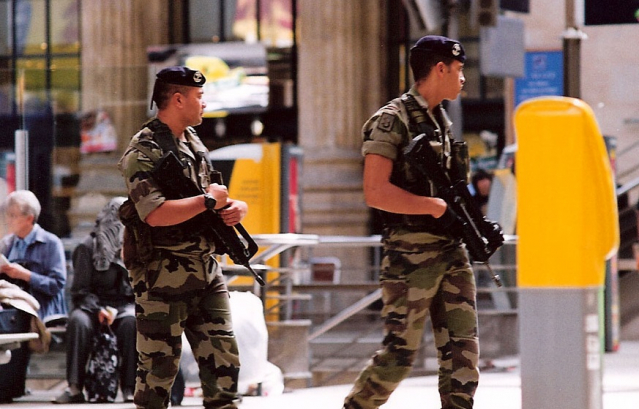 soldiers with guns on patrol at Gare du Nord in Paris