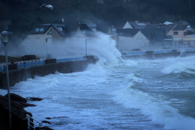 Waves crashing into the seafront of a French town on the Atlantic coast