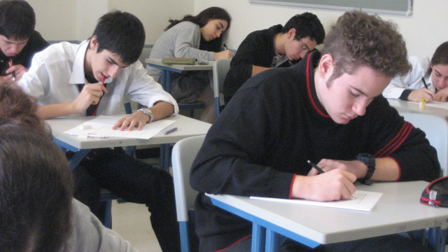 Students doing an exam at desks
