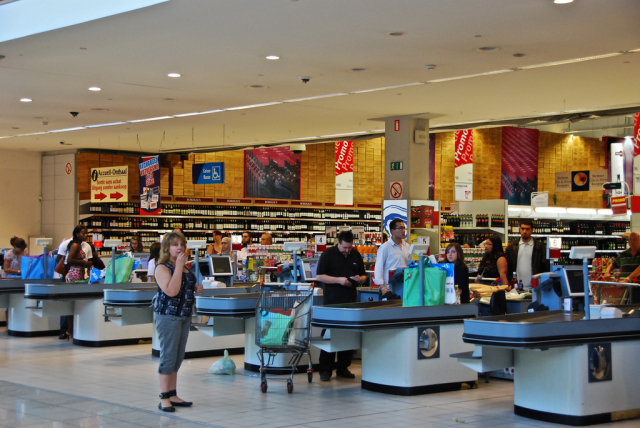 shoppers queue at supermarket checkouts in France