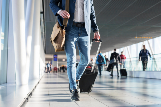 Man travelling with suitcase