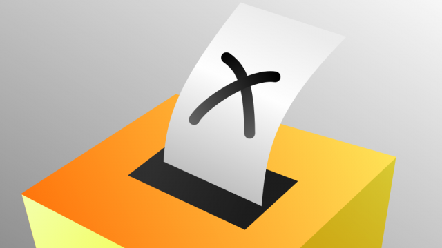 graphic of a vote going into a yellow ballot box