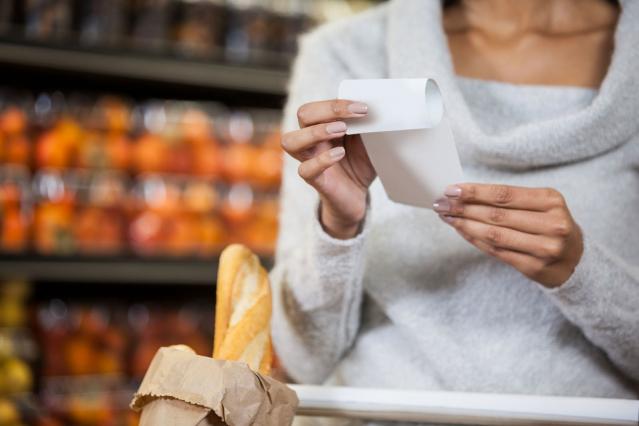 Woman reading receipt