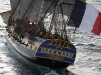 The Hermione flies the flag - Photo: Francis Latreille/Association Hermione