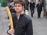 A Frenchman is never without his baguette