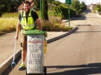 Hervé Pighiera is collecting all the litter he can reach