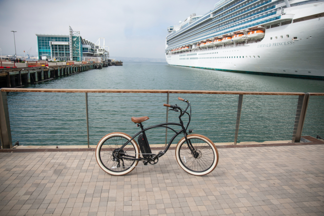 A Tower electric bike by a cruise ship.