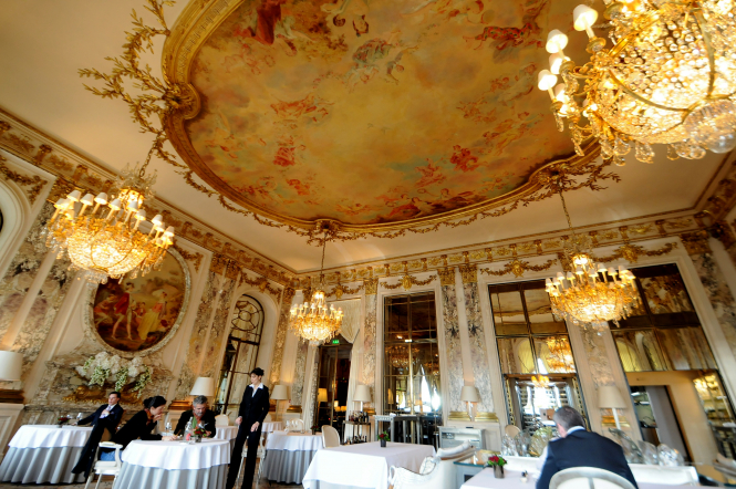 A dining room with chandeliers at Le Meurice hotel in Paris. Luxury Paris hotels, known as palaces, will stay closed this summer due to lack of visitors post Covid-19.
