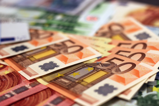 A pile of euro notes. A woman has found €500,000 in a suitcase in a Paris apartment she inherited.