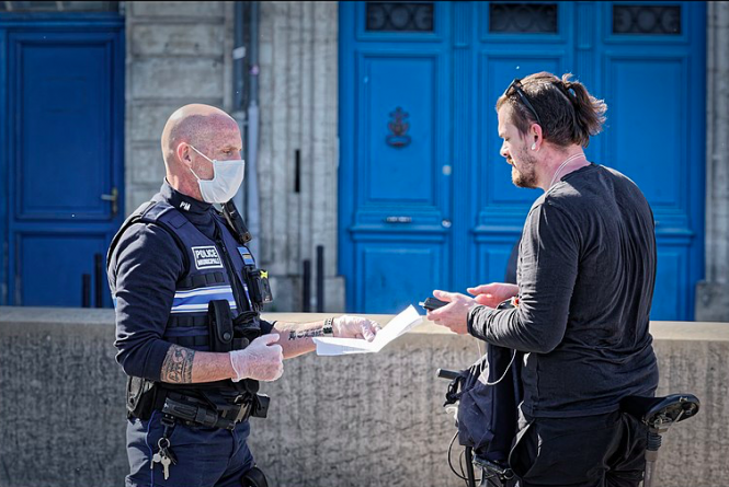 A policeman checks an attestation form in Bordeaux. France lockdown: What papers do I need to leave the house?