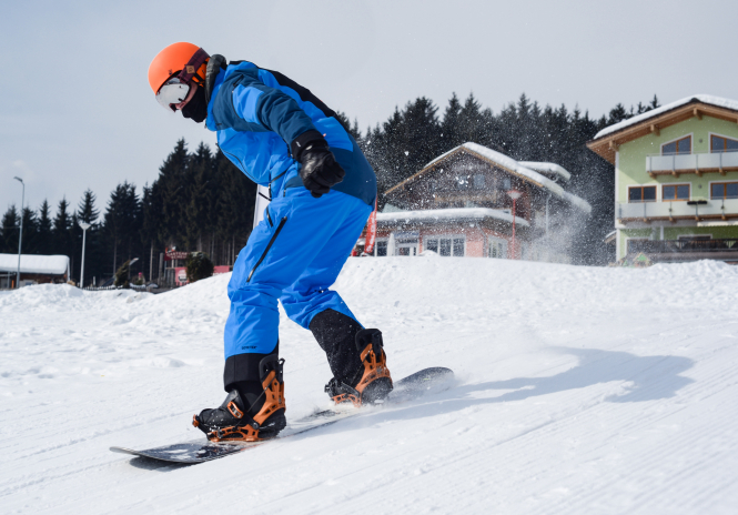 A skier in front of chalets. French Alps ski station opens to show Covid health protocol
