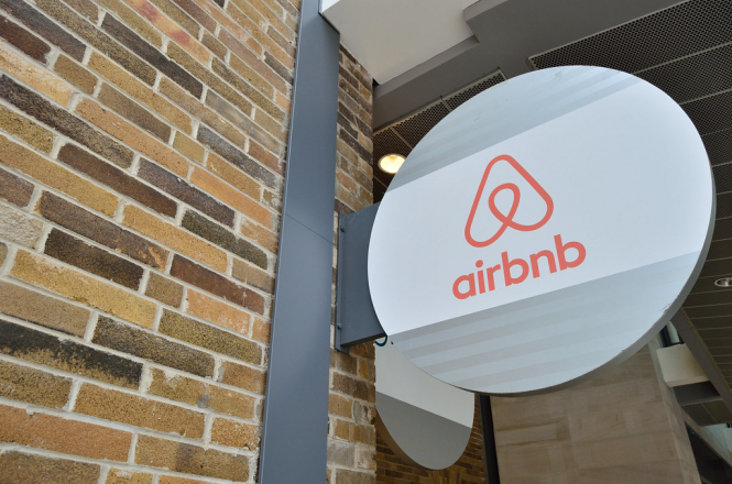 The Airbnb logo on a sign. Airbnb rules in Paris upheld by European Court of Justice