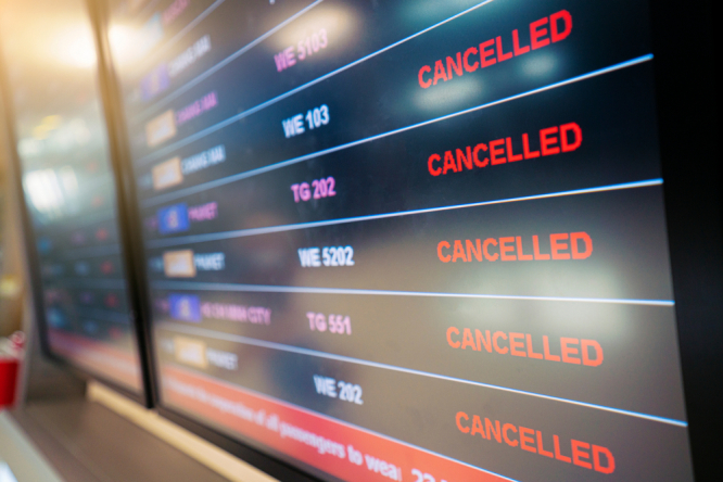 Flights cancellation status on flights information board in airport because of coronavirus. Millions in Europe hit by lack of Covid travel refunds, says EU court