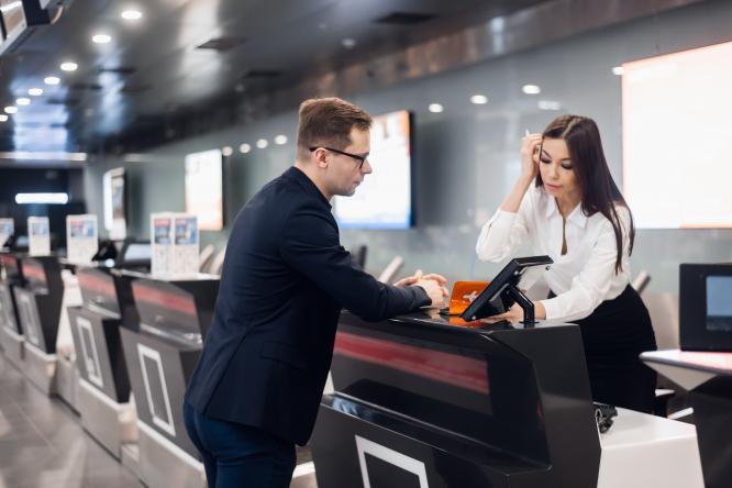 A man checks in at an airport