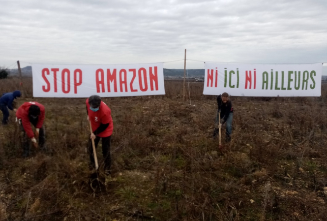 Protesters set up banners against Amazon. Protests against Amazon warehouses across France