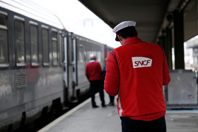 An SNCF worker on a train platform. Call for rail strike in Paris region on June 21, across France in July