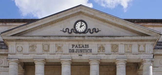 Frontage of French court with clock