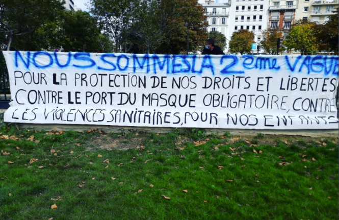 An anti-mask banner. Small anti-mask protest in Paris ends with mass mask fines from police