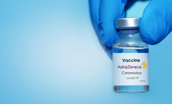Doctor's hand in a medical glove holds a bottle with Covid-19 vaccine with AstraZeneca logo. France Covid cases fall below UK for first time since February as vaccine efficacy comes under scrutiny