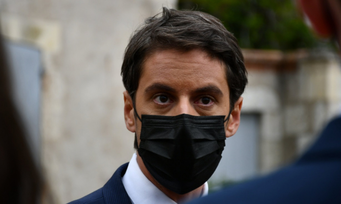 Government spokesperson Gabriel Attal in a black mask. Vulnerable people still priority for Covid vaccination in France