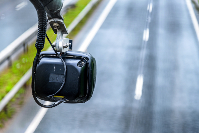 An average speed check camera monitor over a road. Speeding driver in France claims didn't know how speed cameras work