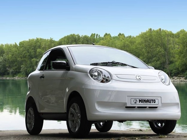A white electric vehicle by Aixam. Electric car sales in France boom during lockdown
