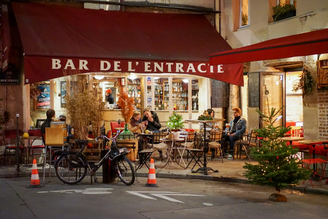 A cafe in France with people sitting outside